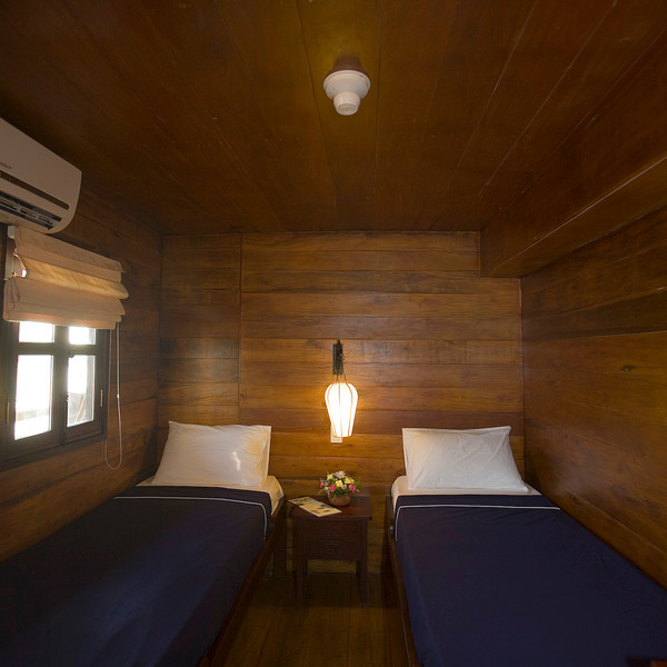 Twin-bedded cabin along Cai Be -- Can Tho